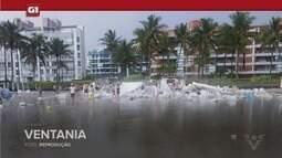 G1 em 1 Minuto - Santos: Cadeiras e barracas ficam amontoadas em praia após vendaval