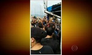 Morte de jovem durante tiroteio provoca protesto em favela do Rio