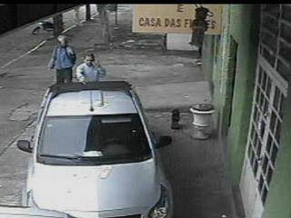Frame from a security video camara taken just seconds before gunman shoots dead a business man in Rio Grande do Sul, Brazil