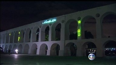Arcos da Lapa ganham iluminação especial para a Copa do Mundo - Uma projeção a laser de grafismos e pontos turísticos cariocas foi inaugurado nos Arcos da Lapa. Ela também projeta as bandeiras dos 32 países que vão disputar o mundial.