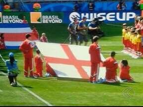 Estudante em Araguari relata emoção de levar bandeira da Inglaterra em jogo - Lineker levou bandeira na partida contra a Costa Rica. Participação foi garantida após sorteio em concurso de fotografia.
