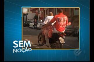 'Sem Noção' flagra dupla transportando peça de carne em motocicleta pelas ruas de Belém - Flagrante foi registrado no bairro de Canudos.