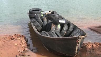 Contrabandista foge com motor nas mãos e deixa barco cheio de pneus - Outra apreensão também foi feita do rio Paraná