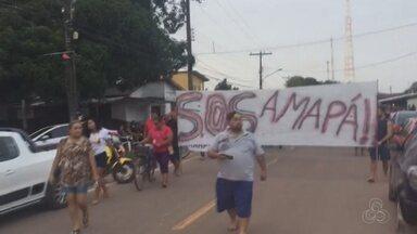 Moradores realizam caminhada pela paz pedindo mais segurança no município de Amapá - Morte de um homem e constantes assaltos motivaram o ato. Caminhada ocorreu nesta segunda-feira (13).