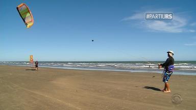 #PartiuRS: praia do Cassino é cenário para praticar esportes náuticos - Assista ao vídeo.