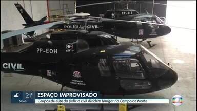 Grupos de elite da polícia civil dividem hangarcom goteiras no Campo de Marte - Garra e GER foram desalojados de prédio no Centro e estão em espaço improvisado junto a helicópteros.