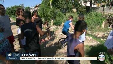 Rj Móvel estaciona em Sâo Gonçalo - Moradores do bairro Jóquei pedem passarela para atravessar valão.