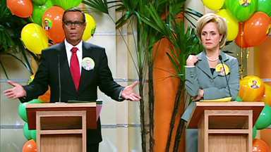 Em Pratos Limpos - Arnaldo-Obama e Celinha-Hillary! Ex-casal disputa eleição de síndico do Jambalaya. No debate, verdades são ditas. Quem vence?