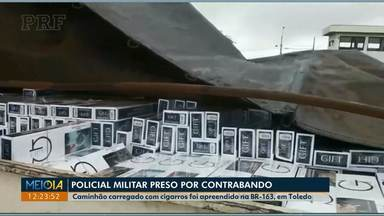 Policial Militar é preso por contrabando - Ele dirigia um carro que dava apoio a uma carreta carregada de cigarros paraguaios.