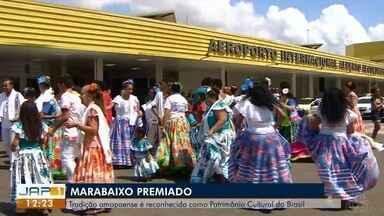 Grupos celebram em aeroporto reconhecimento do marabaixo como patrimônio do Brasil - Ativistas chegaram na manhã deste domingo (11) ao AP após acompanharem eleição feita pelo Iphan no Pará, na quinta-feira (8).