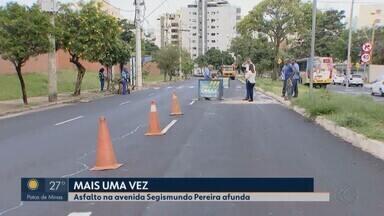 Avenida Segismundo Pereira segue parcialmente interditada para reparos em Uberlândia - Equipes do Dmae e da Secretaria de Obras trabalham para consertar o asfalto danificado com as chuvas.