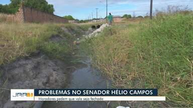 Moradores de Boa Vista cobram fechamento de vala aberta há quase 10 anos - Problema acontece no bairro Senador Hélio Campos, zona Oeste da capita.