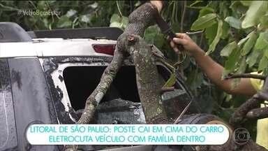 """Poste cai em cima de carro e 'eletrocuta' veículo com família dentro em São Vicente (SP) - Após o temporal, uma árvore caiu, atingiu um poste energizado, que ficou em cima de um carro """"eletrocutando"""" o veículo.A família teve que ficar várias horas dentro do veículo até conseguir sair."""