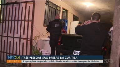 Três pessoas são presas em Curitiba em uma operação coordenada pela polícia do RJ - Segundo a polícia, as pessoas eram usadas como laranjas de uma empresa que lavava dinheiro de traficantes do Morro do Borel, na Barra da Tijuca, no Rio de Janeiro.