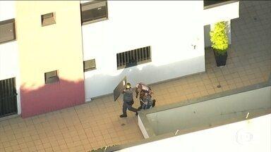 Homem dispara contra policiais num prédio na zona sul de São Paulo - Tudo começou com uma discussão sobre a venda de um carro