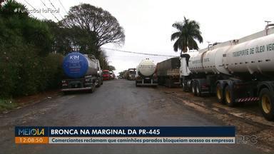 Comerciantes reclamam que caminhões parados bloqueiam acesso às empresas - Eles reclamam da falta de sinalização e dos caminhões que ficam parados na marginal da rodovia.