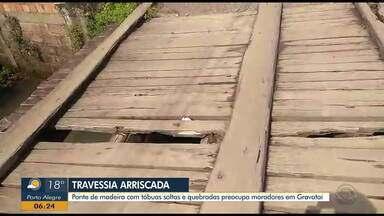 Ponte de madeira com tábuas soltas e quebradas preocupa moradores em Gravataí - População fala que situação já dura 20 anos. Secretário de Obras afirma que ponte está no cronograma de reformas.