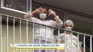 Moradores do RJ enfrentam o quinto dia de greve na saúde municipal - A prefeitura do Rio ainda não acertou as contas com os terceirizados da saúde, que estão sem receber salário há meses. A população é quem se mobiliza para ajudá-los. com a doação de alimentos, na porta dos hospitais.