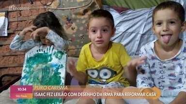 Menino de 6 anos faz vídeo para vender desenho da irmã e reformar casa - Isac teve a casa afetada pelas chuvas