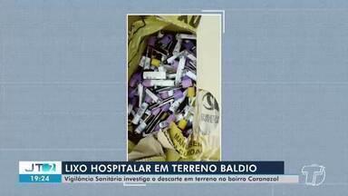 Vigilância Sanitária investiga o descarte irregular de lixo hospitalar em terreno - Resíduos foram encontrados por moradores em terreno baldio no bairro Caranazal.