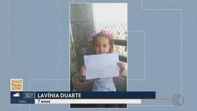 Menina de 7 anos faz desenho sobre a bênção com o helicóptero em Juiz de Fora - Lavínia Duarte colocou no papel a emoção que sentiu com o sobrevoo visto de casa no Dia de Corpus Christi. Do céu, padre abençoou a cidade.