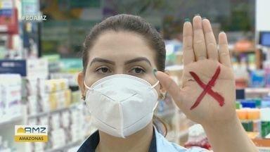 'Sinal Vermelho': vítimas de violência doméstica podem pedir ajuda em farmácias do AM - Campanha da Associação de Magistrados e Conselho Nacional de Justiça envolve farmácias de todo país. 'X' desenhado na mão identifica mulheres vítimas; veja como denunciar.