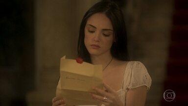 Anna se enfurece com o presente que recebe de Thomas - Em bilhete ele afirma que a levará de volta para casa depois da audiência