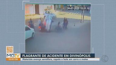 Motorista avança sinal, capota e bate em carros e motos em Divinópolis - Acidente ocorreu na Avenida Autoroma. De acordo com a Polícia Militar (PM), nenhum dos envolvidos ficou ferido. Condutor que avançou o semáforo deixou o veículo no local e fugiu.