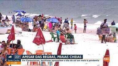 Banhistas aproveitam dia de sol na praia de Canasvieiras em meio à pandemia - Banhistas aproveitam dia de sol na praia de Canasvieiras em meio à pandemia