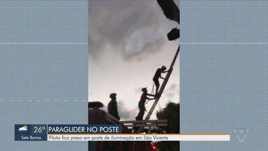 Piloto de paraglider fica preso em um poste de iluminação em São Vicente - Caso aconteceu no domingo. O piloto saltou do Morro Voturuá.