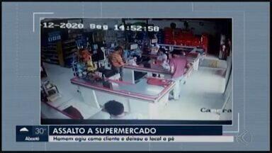 Vítimas reconhecem suspeito de assalto em supermercado de Divinópolis - Imagens mostram o assaltante comprando como se fosse um cliente comum. Quando a funcionária abre o caixa para dar o troco, o assaltante pega alguma coisa no bolso e anuncia o assalto.