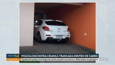Polícia encontra criança trancada dentro de carro - Policiais foram conter uma briga de casal quando encontraram a criança dentro do carro, na garagem.