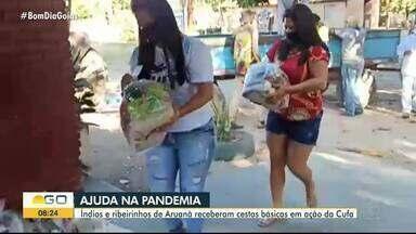Índios e ribeirinhos de Aruanã recebem cestas básicas em ação da Cufa - Ação beneficiou pelo menos 500 indígenas.