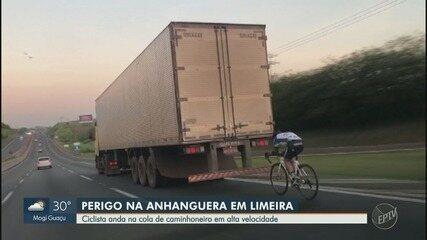 Ciclista é flagrado pedalando 'no vácuo' de caminhão na Rodovia Anhanguera, em Limeira