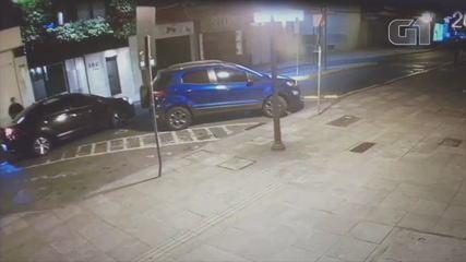 Imagens divulgadas pela polícia mostram vítima entrando em carro