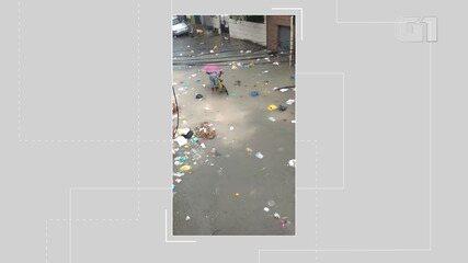 Água da chuva espalha lixo pela Rua Jornalista Nelton França, no bairro do Uruguai