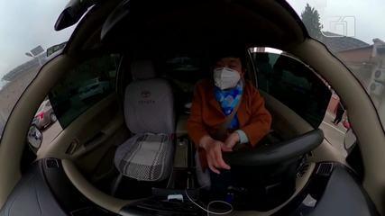 Motoristas chineses criam barreiras para conter o coronavírus