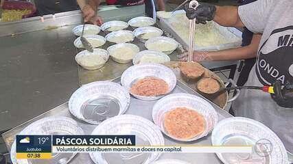 Páscoa solidária: voluntários distribuem marmitas e doces na capital