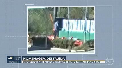 Homem destrói balões que lembravam vítimas do rompimento, em Brumadinho