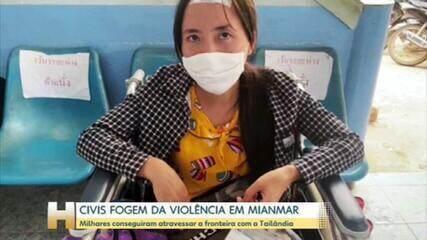 Civis feridos fogem de Mianmar e cruzam fronteira com a Tailândia