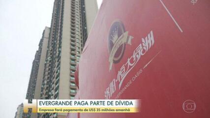 Gigante chinesa Evergrande anuncia pagamento de pequena parte de sua dívida