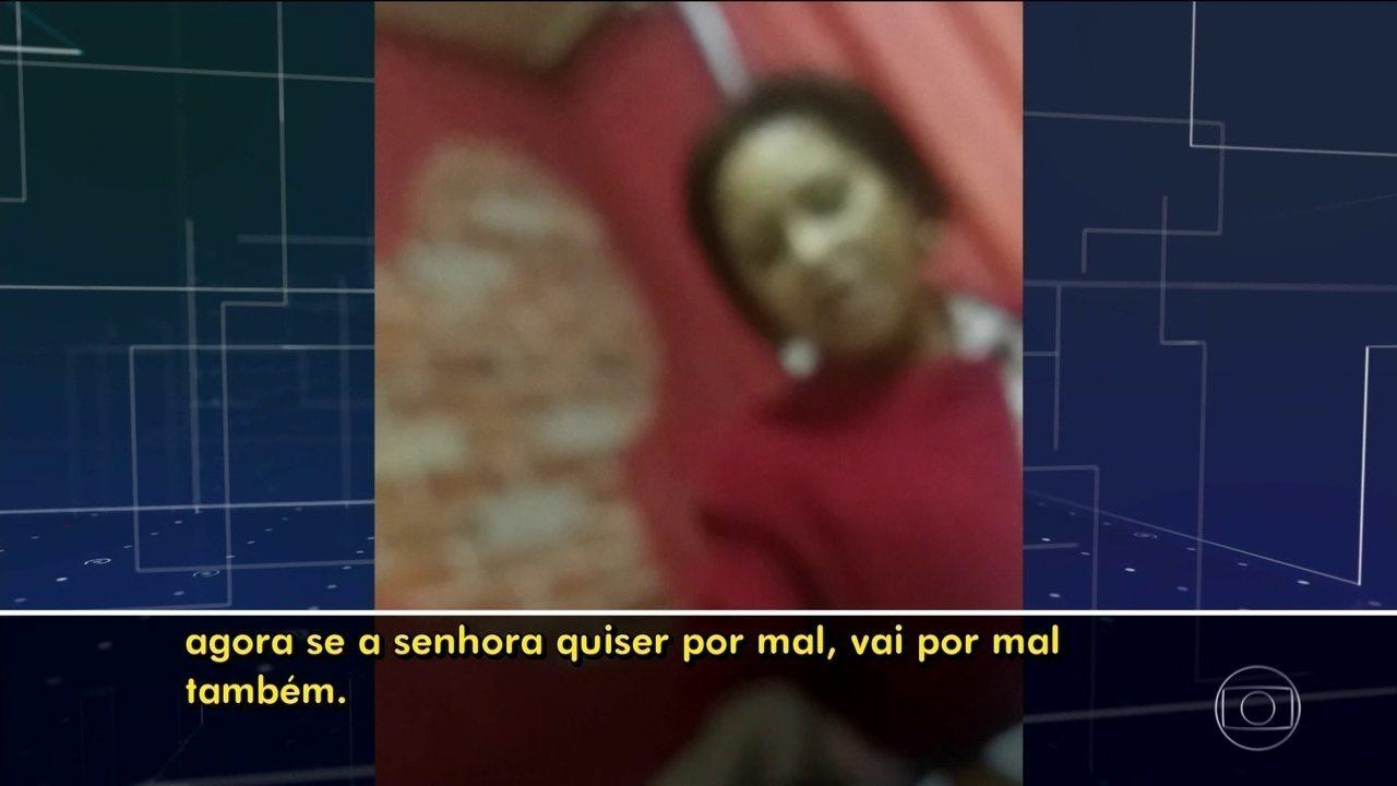 Em gravação, mulher cobra dinheiro de moradores de prédio abandonado